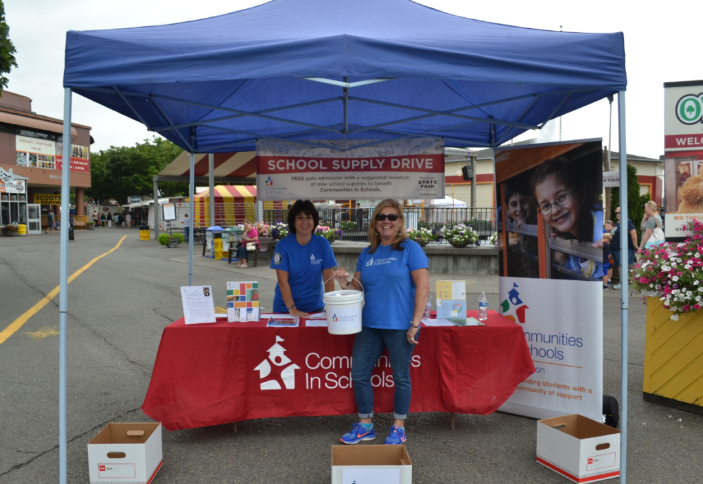 Volunteers at the state fair school supply drive